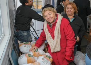 woman receiving turkey from Market at Gray House
